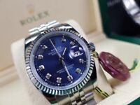 Rolex DateJust, Silver with a Navy Face & Timestones. Box & paperwork included. £140.