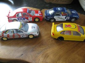 4 scalextric cars all with lights