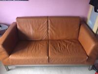 Herman orange leather 2 seater couch