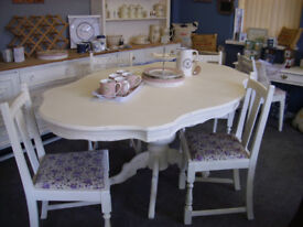 painted table and four chairs