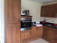 Kitchen cupboard doors, gas hob and extractor fan