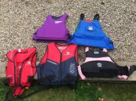 Selection of life jackets for sale