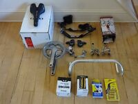 Various cycling items - Garage Sale! Switchgear, helmets, saddles, bar extensions, Tri Frame