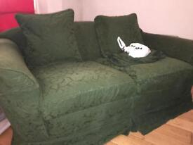 Two seater sofa. Feathered seat cushions. Excellent condition. FREE