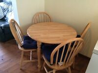 Solid beech dining table and 4 chairs, nearly new