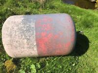 Orange and white fibreglass buoy