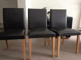 Six brown leather dining chairs originally from Lee Longlands