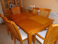 Dining table and 6 chairs (2 carvers) with extending leaf. Well used but still attractive.