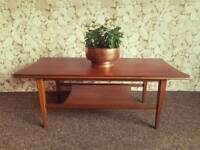 Teak Danish style concave side coffee table. With shelf