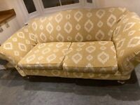 Lovely light yellow used large 2 seater sofa