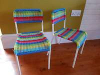 Two multi coloured kids chairs