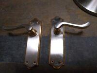 7 pairs of brass coloured door handles