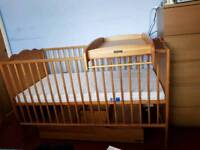 Mamas and Pappas baby cot with baby changer and drawer.