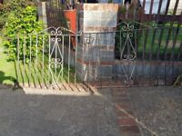Wrought iron gates with new hinges