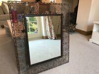 Mirror with decorative metalwork surround