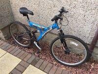 Cheap bike for sale. Blue Optima Cylcone adult bike.