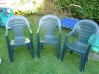 3x plastic garden chairs.