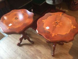 Pair of pedestal side tables .