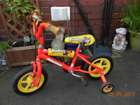 magna fun race bike with stabilizers hardly used