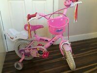 Girls peppa pig 12 inch bike with stabilisers, dolls seat, bell, fringed handlebars and basket