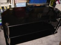 Smoked Glass and Chrome T. V. Table