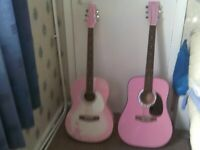 2 PINK GUITARS 40 IN LONG BUYER COLLECTS