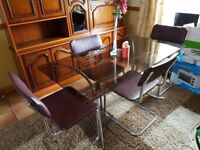 Glass and Metal Dining Table and four Chairs