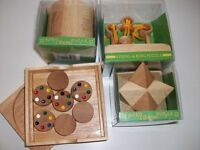 Wooden puzzles - boxed and unused. Would make super present.