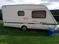 2 Berth Sterling Europa 460/2 Caravan (2003) + full awning, motor mover & much more.