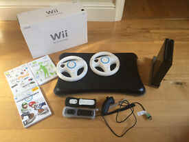 Nintendo Wii fit plus pack with balance board and 3 games + 2 steering wheels
