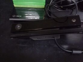 Xbox one with games and a pad