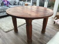 Round dining table and 4 brown leather Next chairs beautiful hardwood lots of character.