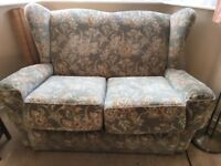 Vintage two seat sofa and matching armchair
