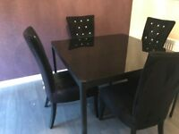 Black glass dining table - perfect condition