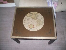 Small table with old map and glass top