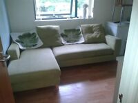 Chaise sofa in apple green with matching storage footstool