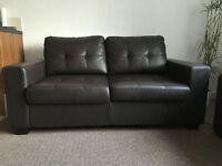Two-seater dark brown leather sofa bed