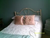 Cream Metal framed double bed with Mattress.