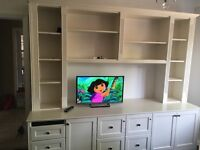 Large wooden unit with drawers and shelves