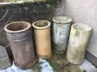 4 LARGE CHIMNEY POT PLANTERS GOOD CONDITION... CAN SELL INDIVIDUALLY --- CAN DELIVER LOCALLY --