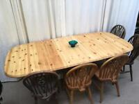 Extending painted vintage pine table; seats up to 10. New renovation.