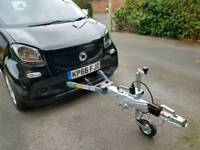 Smart For Four Passion with Car-a-Tow for towing with motorhome