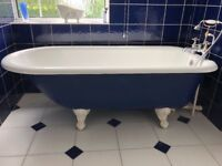 Ceramic roll top bath with ball and claw feet, matching sink and toilet