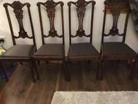 Four solid dark wood dining chairs tweed upholstered seats