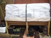 1.8m Vegtrug with greenhouse frame and covers.