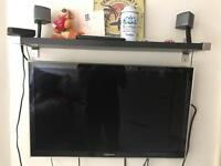 Samsung 32inch HDTV with Bose companion 3 series 2 speakers or Harmon kardon sound sticks