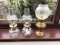 2 glass and 1 brass effect oil lamps