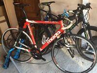 Moda Tempo modern road bike and static trainer for sale