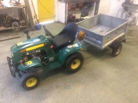 Petrol tractor and trailer John Deer