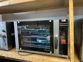 Commercial electric convection oven with spray function